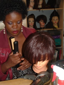 Laurayne styling her weave at the World of Braiding Training